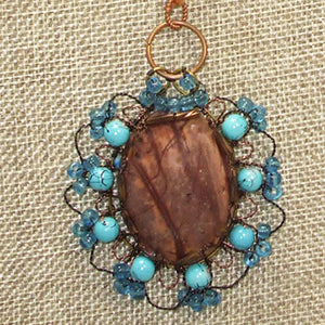 Bakana Rhyolite Cabochon Pendant Necklace front bugs eye view