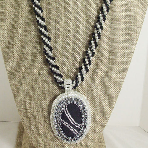 Falda Bead Embroidery Crochet Pendant Necklace close up front view