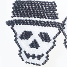 Load image into Gallery viewer, Bonnie Brick Stitch Halloween Earrings boy close view