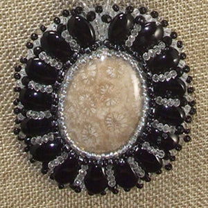 Eadda Beaded Fossilized Coral Cabochon Necklace pin up view