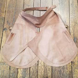 "Farrier leather apron, double layered legs for a nail and heat barrier. Double stitched seams, knife pocket on each side. Length 33"" x 27.5 wide"