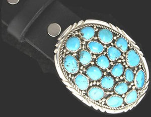 This Turquoise Cluster Sterling Belt Buckle by artist Arnold Goodluck holds a spectacular offering of natural, turquoise stones. These gorgeous stones are bezel set on and surrounded in Sterling.