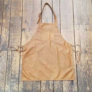 "Soft leather apron, 3 pockets with over the neck straps and ties at the waist. Regular length 28"" long x 24.5"" wide"