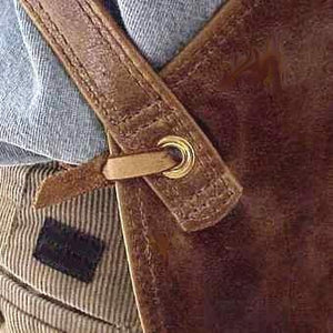 "Soft pocketed leather apron with cross back straps and ties at the waist. Long version 38"" long x 24.5"" wide"