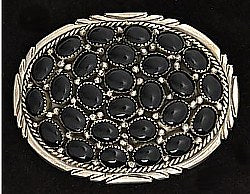 A cluster of 27 black onyx set in a sterling silver oval belt buckle with detailed design around the edge of the buckle. line design going horizontally across the buckle.    Belt loop width measurement: 1.5""