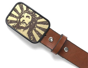 "Surrounded by a black tone finish, this horizontal belt buckle features a vintage style portrayal of Jesus. This motif will stand out on any belt and outfit.  Belt loop width measurement: 1.5"" or 1.75"""