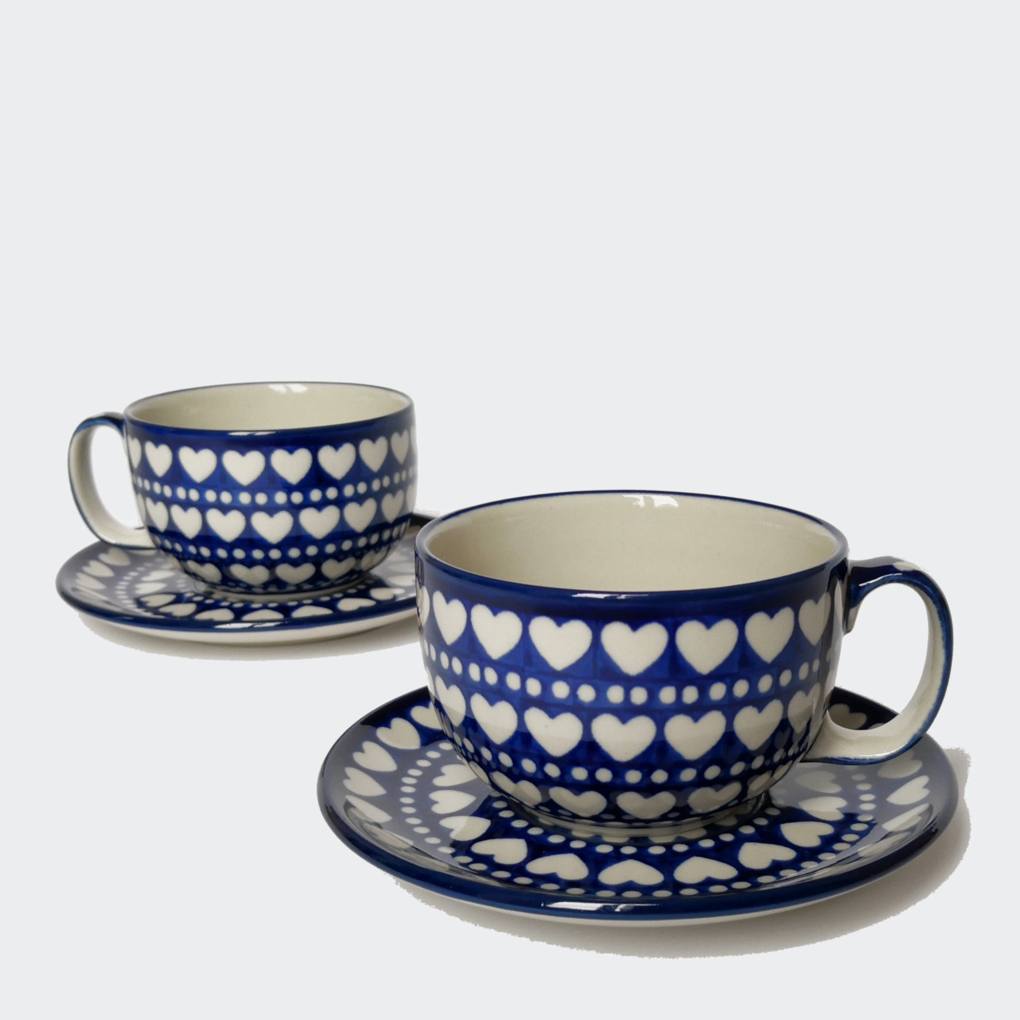 Pair of Large Boleslawiec Stoneware Cups and Saucers in Dark Blue and White Hearts and Dots Pattern