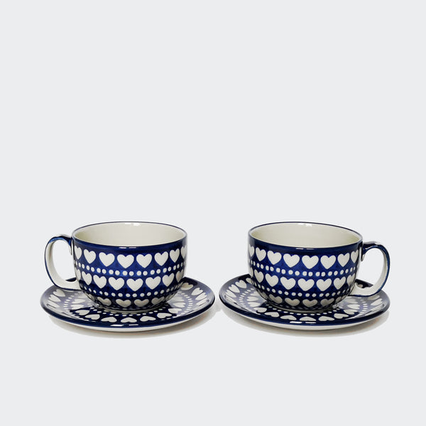 Two Large Blue and White Stoneware Cups and Saucers with a Hearts and Dots Pattern