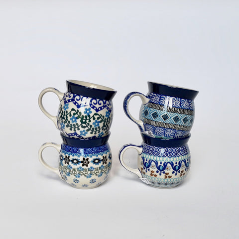 Four small hand-decorated stoneware bubble mugs by Ceramika Artystyczna