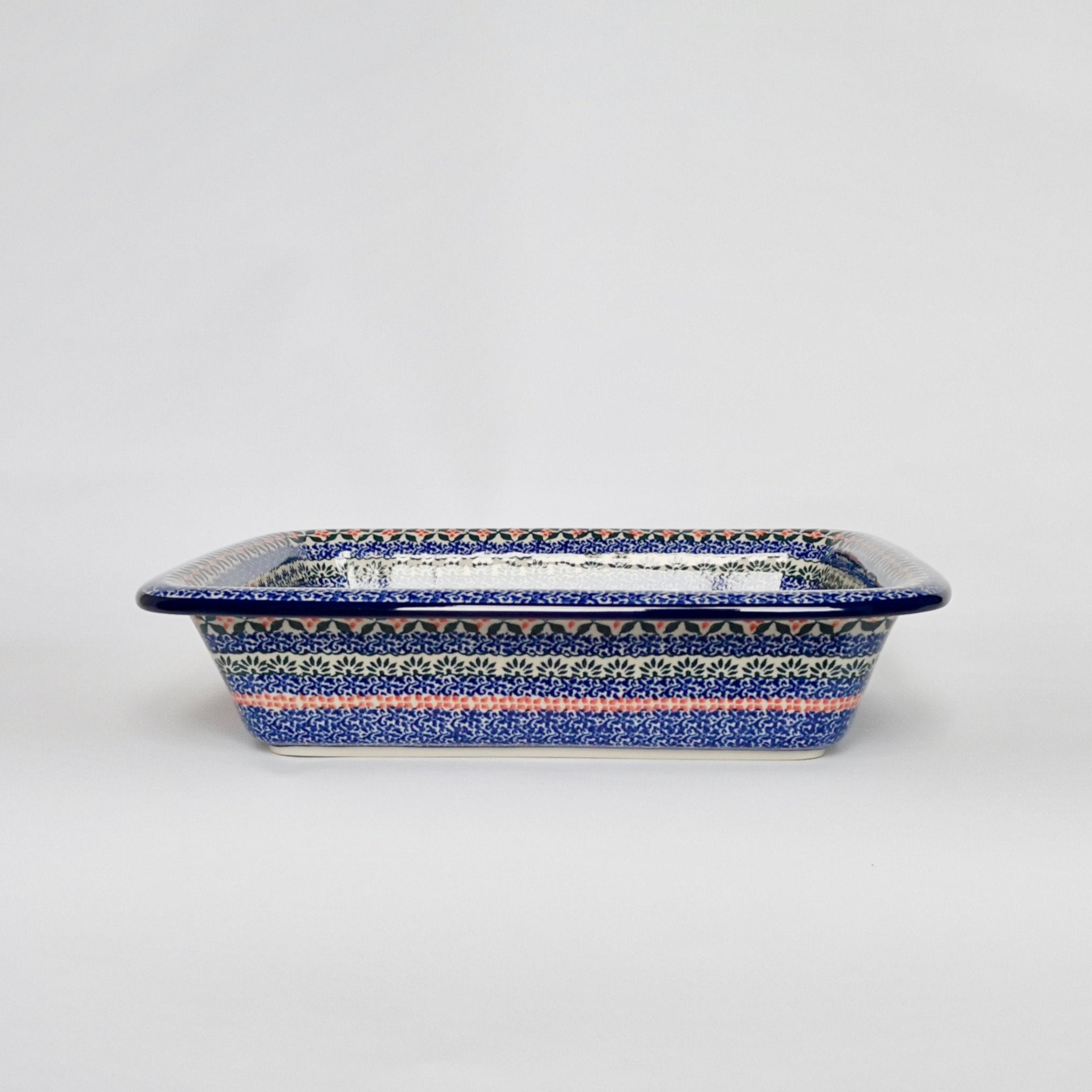Deep patterned handmade ceramic baking dish with rolled edge in dark blue
