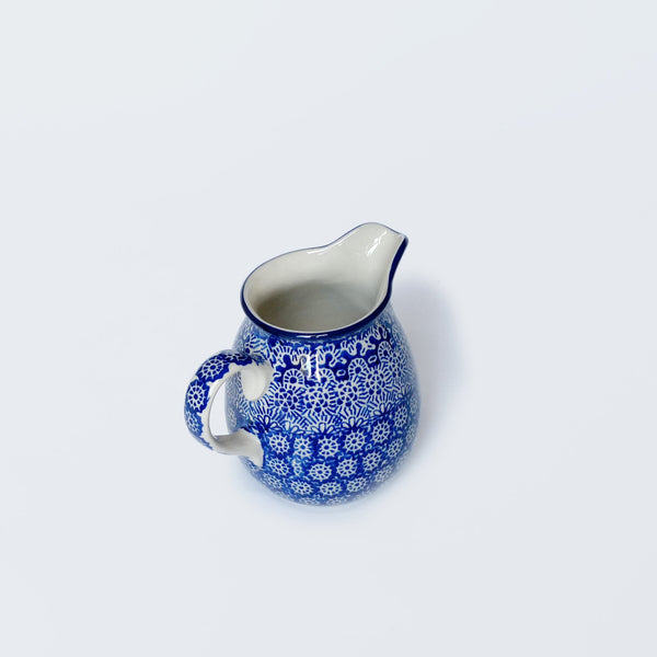 Handmade ceramic milk jug in dark blue spongeware print