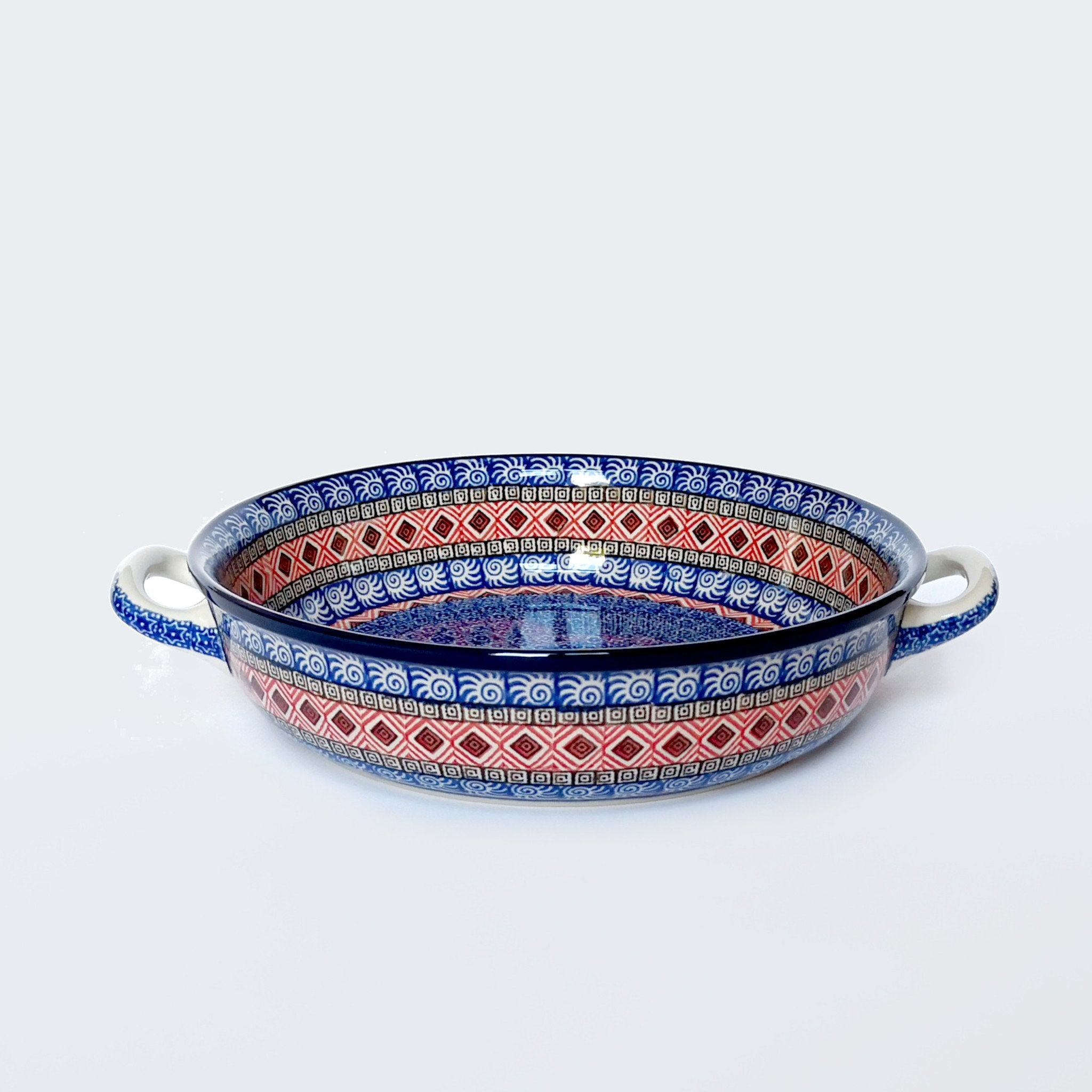 Large round red and blue handled oven dish in Polish Pottery made by Ceramika Artystyczna