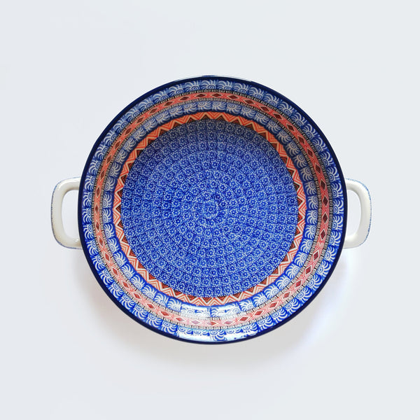 Large round oven dish with handles in Polish Pottery made by Ceramika Artystyczna, red and blue moroccan pattern.