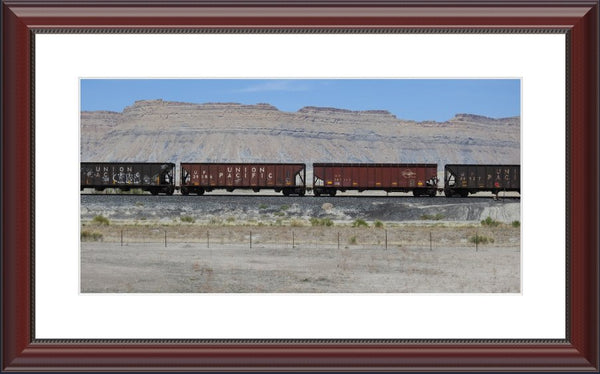 Desert Train by Lowe in a 10 x 20 print Framed with mat in a Beaded Mahogany Frame - Schmidt Fine Art Gallery