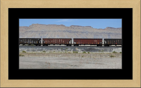 Desert Train by Lowe in a 10 x 20 print Framed with mat in a Blonde Maple Frame - Schmidt Fine Art Gallery