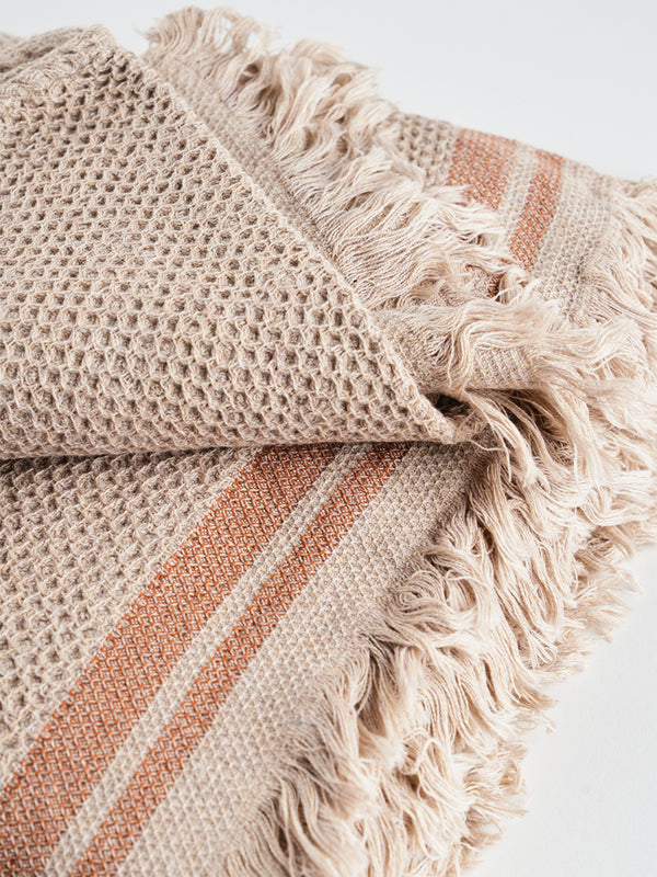 RUST STRIPED THROW.