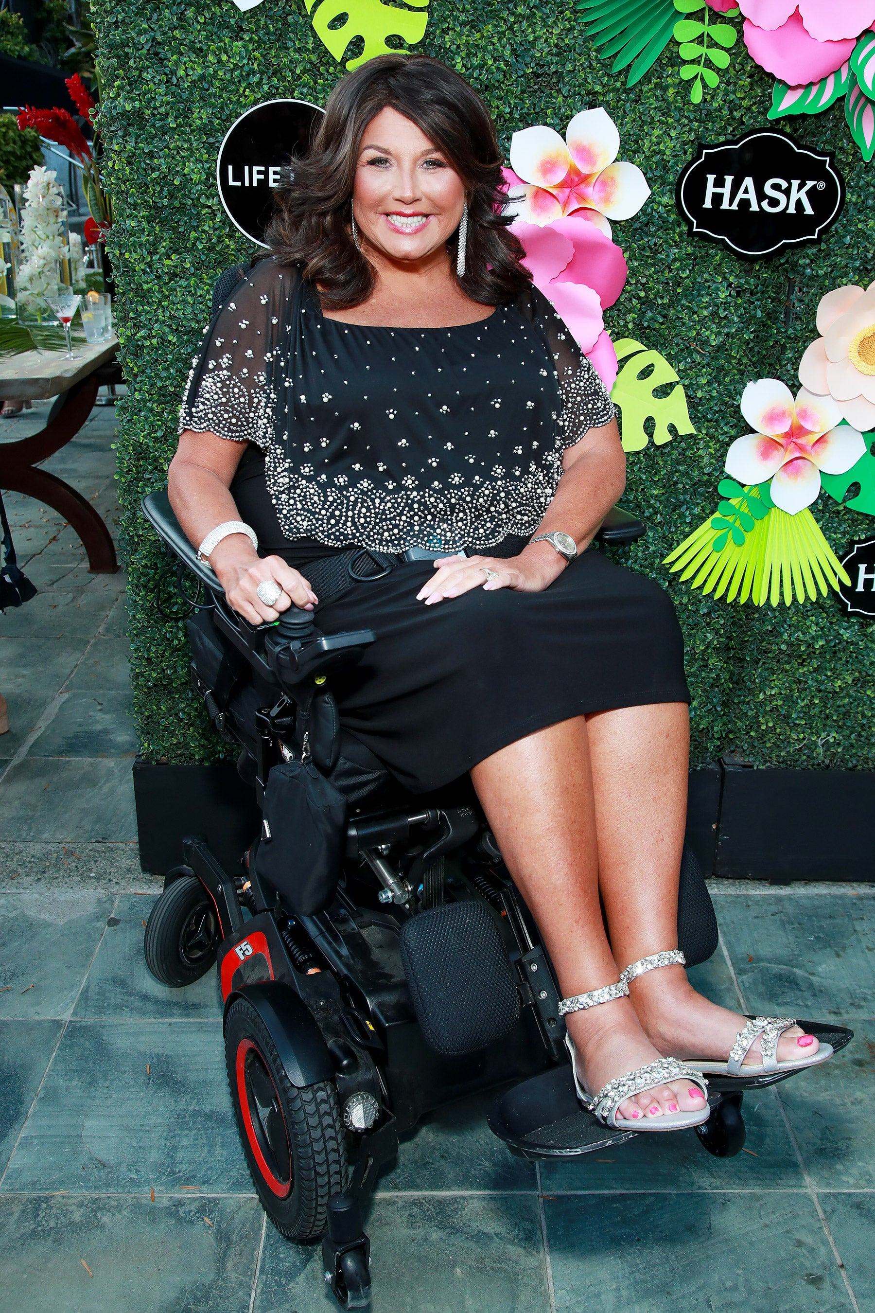 Abby Miller from Dance Moms in a wheelchair