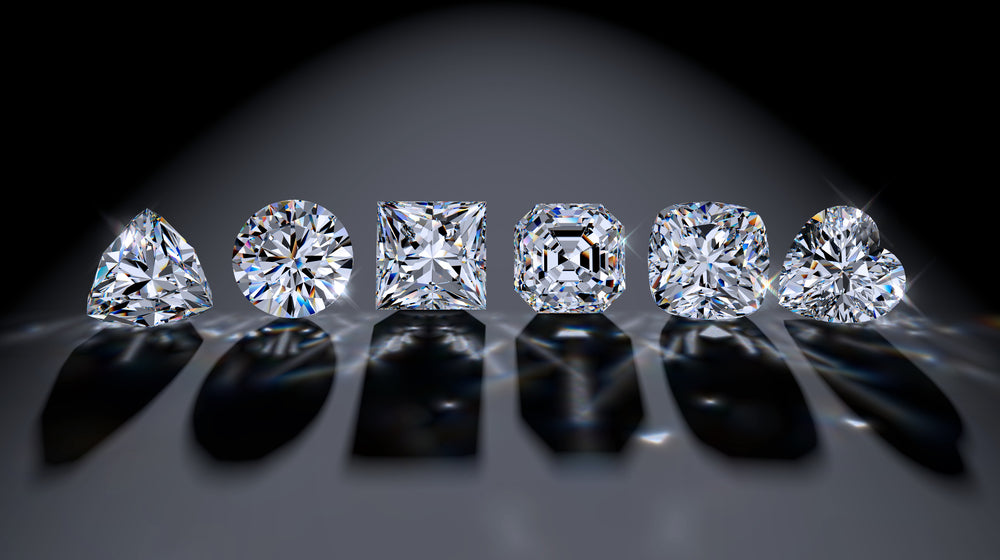 several diamonds of different shapes on a dark background