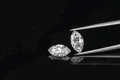 marquise cut diamond on black background