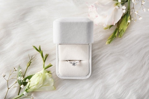diamond engagement ring in a jewellery box