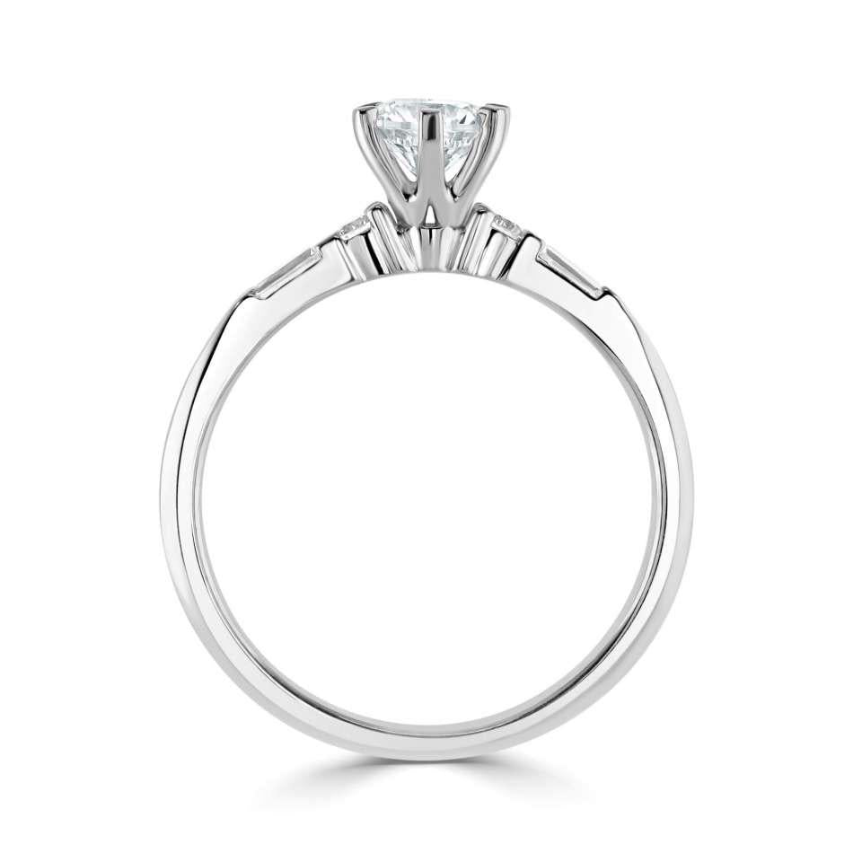 six claw solitaire with tapered baguette and round diamond set shoulders.-Silk Road Diamonds