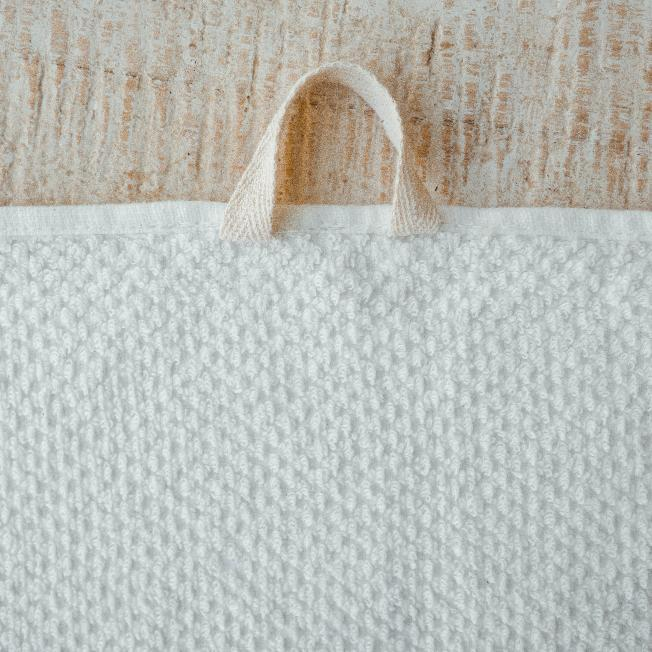 Close up. Anact Hemp Towel. A thoughtful loop allows bathers to hang up to dry with ease! Reap & Sow Refillery Zero-Waste Store