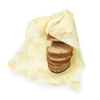 Bread wrapped in honeycomb bees wrap an eco-friendly zero waste product that replaces plastic wrap and ziplock bags
