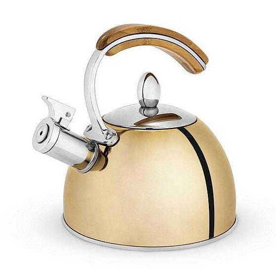 Stainless steel tea kettle is silver and gold with a bamboo handle. Whistles when water is ready.  Loose Leaf Teas or Tea Bags