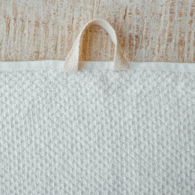 Close up. Anact Hemp Towel. A thoughtful loop allows bathers to hang up to dry with ease! Reap & Sow Refillery Zero-Waste