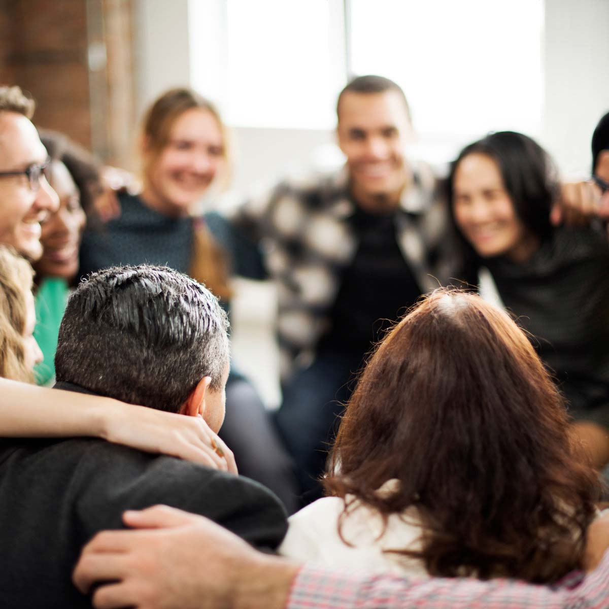 A support group huddles together to show they care for each other