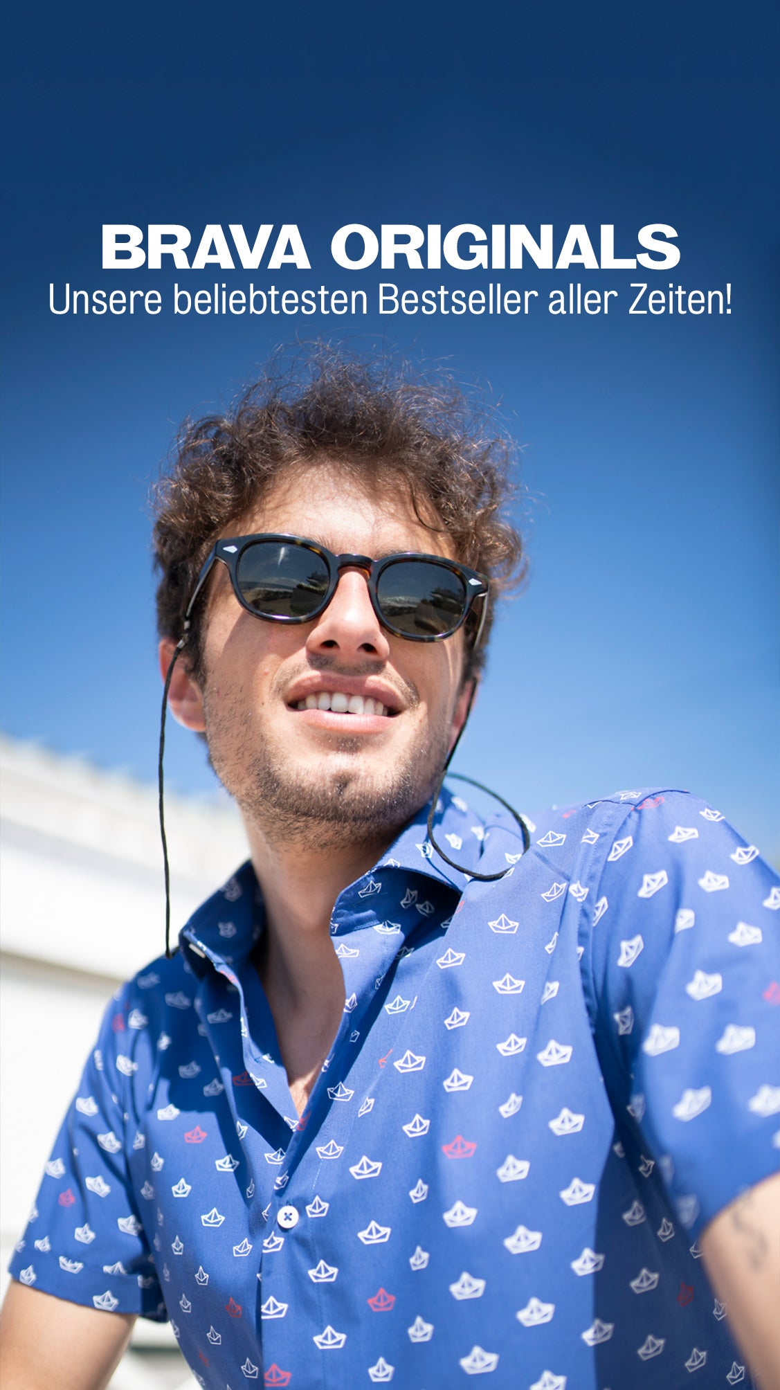 Man with sunglasses and Brava paper boat shirt