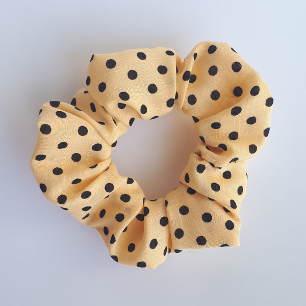 Large yellow polkadot scrunchie