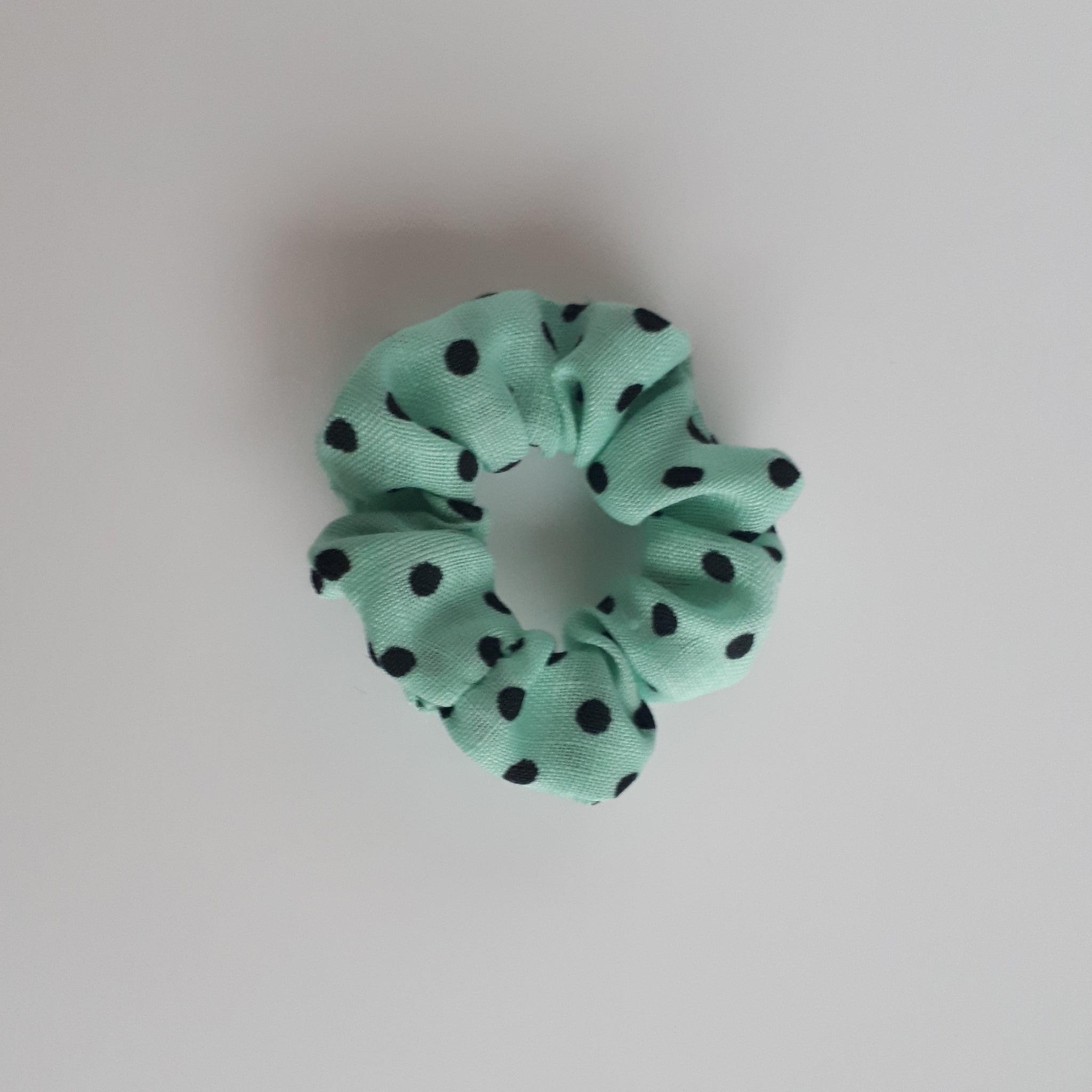 mini blue and black polka dot scrunchie