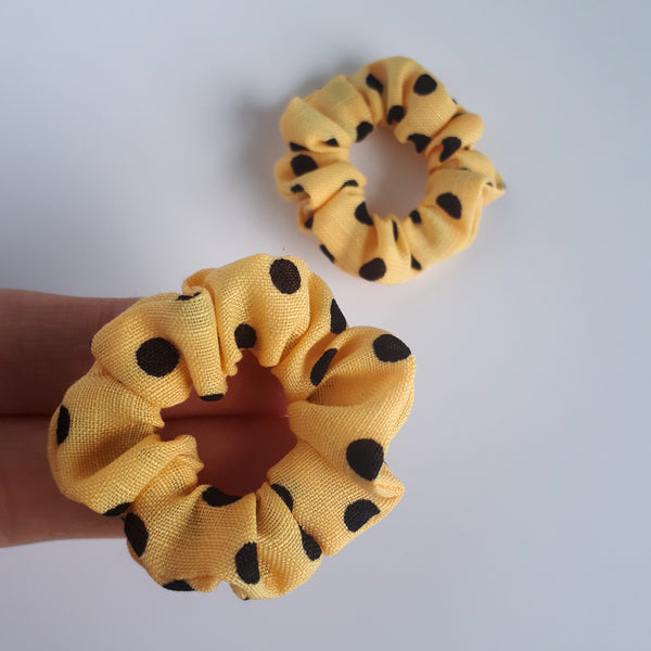 Mini yellow and black polkadot hair scrunchies