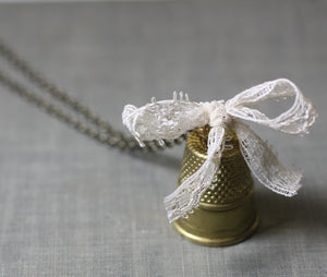 Thimble necklace pendant sew vintage brass cream lace bow seamstress sewing retro