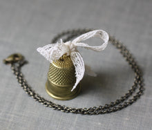 Load image into Gallery viewer, Thimble necklace pendant sew vintage brass cream lace bow seamstress sewing retro
