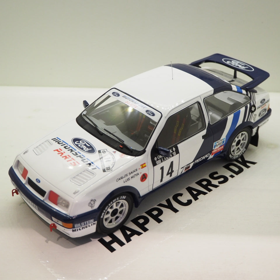 1:18 Ford Sierra RS Cosworth, #14, Rally VM, 1000 lakes Rallye C. Sainz/L. Moya, hvid/blå, IXO, lukket model