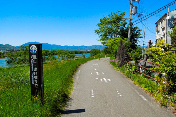 A sign with information useful to cyclists along the Katsura river, Kyoto.