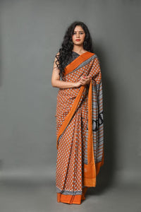 mul mul cotton print saree with pom pom lace saree collection. Orange Black bold saree