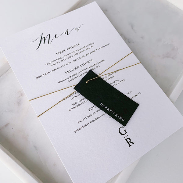 white menu with black personalised swing tag gold tread
