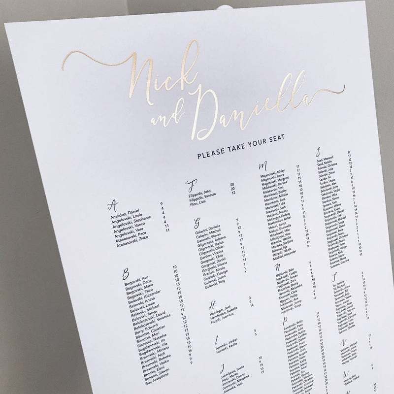 white seating chart with gold decal