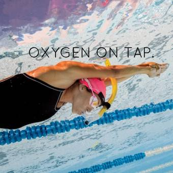 a swimmers snorkel helps get more oxygen into the body for better performance