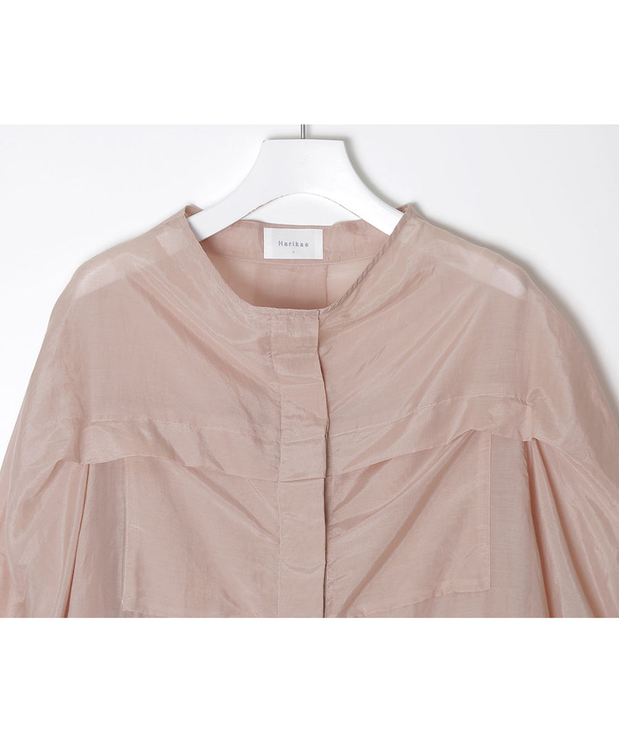 Blouse with tuck