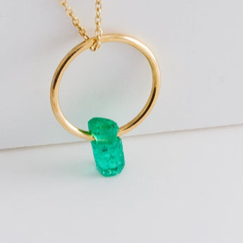 Rough stone emerald pendant
