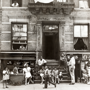 This b&w Harlem stoop scene spreads some old school summer joy.