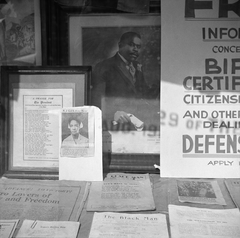 Signs in the windows of a Marcus Garvey club in the Harlem area