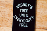 nobody's free until everybody's free (key fob)