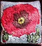 Poppy-A La O'Keefe, rug hooked by Theresa Nevin