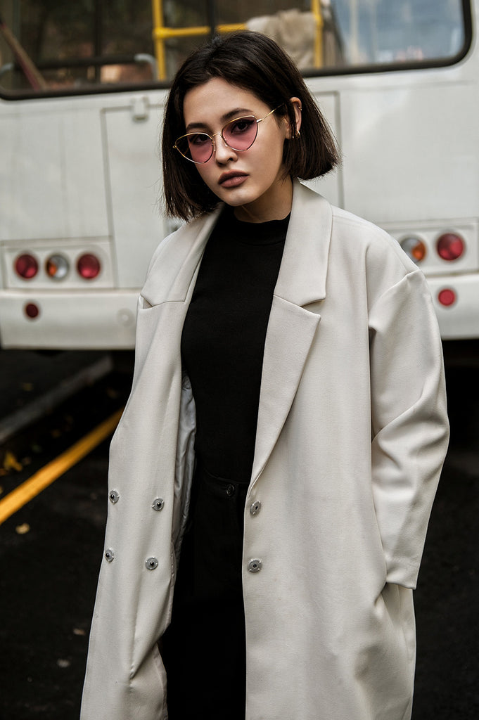 woman wearing cotton shirt with wool coat