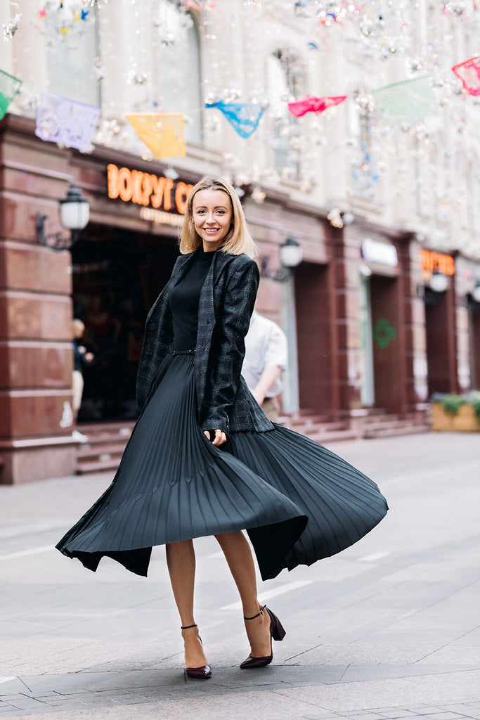 girl in pleated midi skirt and tshirt and blazer and block heels
